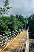 Bemis Bridge in Crawford Notch in Hart's Location New Hampshire; part of the White Mountains. The Bemis Bridge, named after Samuel A. Bemis, crosses the Saco River along Davis Path. It is considered to be an asymmetrical cable stay bridge, and is also the start of the Cohos Trail.
