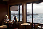 Port Townsend, waterfront coffeehouse, ?Better Living Through Coffee? women knitting, high tide, Washington State, Pacific Northwest, USA,