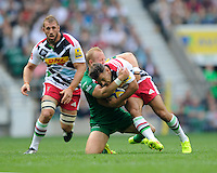 Danny Care of Harlequins is tackled by Shane Geraghty of London Irish during the Premiership Rugby Round 1 match between London Irish and Harlequins at Twickenham Stadium on Saturday 6th September 2014 (Photo by Rob Munro)