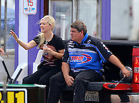 Apr 25, 2015; Baytown, TX, USA; NHRA top fuel driver Jenna Haddock (left) with husband Terry Haddock during qualifying for the Spring Nationals at Royal Purple Raceway. Mandatory Credit: Mark J. Rebilas-