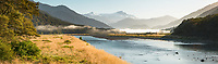 Morning at Haast River with glaciated peaks of Mt. McCullaugh 2266m centre left and Mt. Hooker 2640m centre right at Landsborough of Southern Alps in far distance, South Westland, UNESCO World Heritage Area, New Zealand, NZ