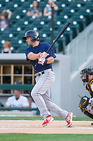 Tyler Henson (9) of the Lehigh Valley IronPigs follows through on his swing against the Charlotte Knights at BB&T Ballpark on May 8, 2014 in Charlotte, North Carolina.  The IronPigs defeated the Knights 8-6.  (Brian Westerholt/Four Seam Images)