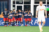 FOXBOROUGH, MA - MAY 22: New England Revolution congratulate Tajon Buchanan #17 of New England Revolution for his goal during a game between New York Red Bulls and New England Revolution at Gillette Stadium on May 22, 2021 in Foxborough, Massachusetts.