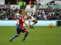 Kyle Naughton of Swansea City (R) moves the ball past \James McArthur of Crystal Palace during the Premier League match between Swansea City and Crystal Palace at The Liberty StadiumSwansea, Wales, UK. Saturday 26 November 2016