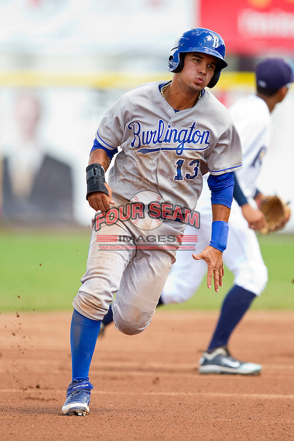 Humberto Arteaga (13) of the Burlington Royals hustles towards third base against the Princeton Rays at Hunnicutt Field on July 15, 2012 in Princeton, West Virginia.  The Rays defeated the Royals 3-1 in game two of a double header.  (Brian Westerholt/Four Seam Images)