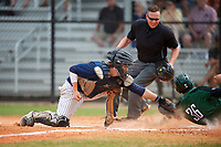 Southern Maine Huskies catcher Kip Richard (31) tags out Trevor Johnson (36) while sliding home as umpire Kyle Klink looks on to make the call during a game against the Dartmouth Big Green on March 23, 2017 at Lake Myrtle Park in Auburndale, Florida.  Dartmouth defeated Southern Maine 9-1.  (Mike Janes/Four Seam Images)