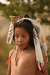 A young Native American Indian boy with a fox fur head covering