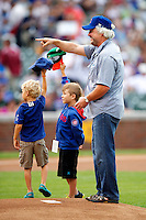 Chicago Cubs guest, actor William Petersen, gets ready to throw out the first pitch before a game against the Houston Astros at Wrigley Field on June 29, 2012 in Chicago, Illinois.  Chicago defeated Houston 4-0.  (Mike Janes/Four Seam Images)