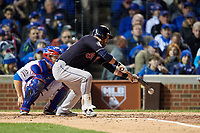 Cleveland Indians Jason Kipnis (22) bunts in the fourth inning during Game 5 of the Major League Baseball World Series against the Chicago Cubs on October 30, 2016 at Wrigley Field in Chicago, Illinois.  (Mike Janes/Four Seam Images)