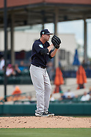 New York Yankees relief pitcher Drew Hutchison (39) looks in for the sign during a Grapefruit League Spring Training game against the Detroit Tigers on February 27, 2019 at Publix Field at Joker Marchant Stadium in Lakeland, Florida.  Yankees defeated the Tigers 10-4 as the game was called after the sixth inning due to rain.  (Mike Janes/Four Seam Images)
