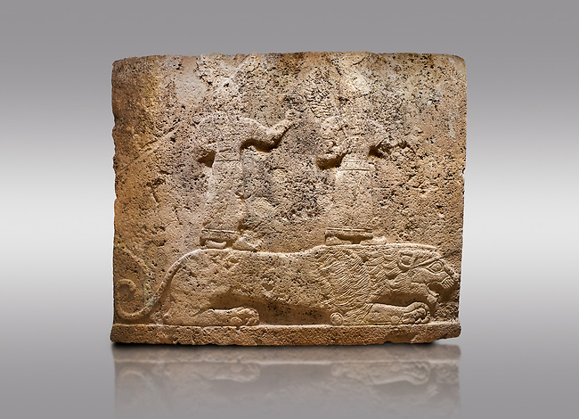 Picture & image of Hittite relief sculpted orthostat stone panel of Long Wall Limestone, Karkamıs, (Kargamıs), Carchemish (Karkemish), 900-700 B.C. Anatolian Civilisations Museum, Ankara, Turkey<br /> <br /> Two figures lying over the lion. There is a crescent at the head of the winged god at the front. It is thought that the figure at the front is moon god and the one at the rear is sun god.