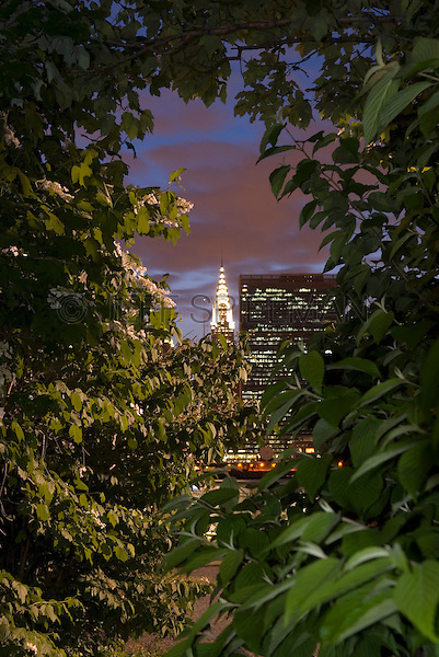 AVAILABLE FROM JEFF AS A FINE ART PRINT.<br /> <br /> AVAILABLE FOR COMMERCIAL AND EDITORIAL LICENSING FROM PLAINPICTURE.  Please go to www.plainpicture.com and search for image # p5690118.<br /> <br /> Midtown Manhattan Skyline Visible thru Trees, Chrysler Building and United Nations Headquarters Visible on the Skyline, New York City, New York State, USA