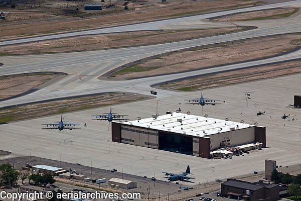 aerial photograph of Kirtland Airforce Base, Albuquerque International Sunport airport (ABQ), Albuquerque, New Mexico; four Lockheed Martin C-130- Super Hercules Aircraft parked in the foreground and middleground