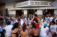 Rio de Janeiro lifestyle, cariocas have fun an drink chope ( draught beer ) at the outside tables of Bracarense bar in Leblon district.