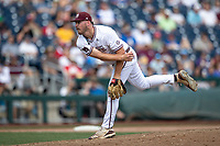 Mississippi State Bulldogs pitcher Riley Self (14) follows through on his pitch during Game 8 of the NCAA College World Series against the Vanderbilt Commodores on June 19, 2019 at TD Ameritrade Park in Omaha, Nebraska. Vanderbilt defeated Mississippi State 6-3. (Andrew Woolley/Four Seam Images)