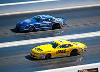 Nov 3, 2019; Las Vegas, NV, USA; NHRA pro stock driver Jeg Coughlin Jr (near) against Fernando Cuadra during the Dodge Nationals at The Strip at Las Vegas Motor Speedway. Mandatory Credit: Mark J. Rebilas-USA TODAY Sports