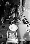 """Paul and Linda McCartney Wings Tour 1975. Paul and Linda share a quite moment on their tour bus while traveling  to Cardiff for that night performance. England. The photographs from this set were taken in 1975. I was on tour with them for a children's """"Fact Book"""". This book was called, The Facts about a Pop Group Featuring Wings. Introduced by Paul McCartney, published by G.Whizzard. They had recently recorded albums, Wildlife, Red Rose Speedway, Band on the Run and Venus and Mars. I believe it was the English leg of Wings Over the World tour. But as I recall they were promoting,  Band on the Run and Venus and Mars in particular."""