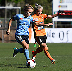BRISBANE, AUSTRALIA - OCTOBER 30: Georgia Yeoman-Dale of Sydney and Amy Chapman of the Roar compete for the ball during the round 1 Westfield W-League match between the Brisbane Roar and Sydney FC at Spencer Park on November 5, 2016 in Brisbane, Australia. (Photo by Patrick Kearney/Brisbane Roar)