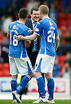 St Johnstone v Dundee United...26.09.15  SPFL   McDiarmid Park, Perth<br /> Tommy Wright celebrates wirth Graham Cummins and Brian Easton at full time<br /> Picture by Graeme Hart.<br /> Copyright Perthshire Picture Agency<br /> Tel: 01738 623350  Mobile: 07990 594431