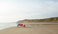 27 JUL 2013 - CROMER, GBR - An official drags a swim buoy to the shore whilst setting up the swimstart of The Anglian at West Runton. Competitors then swam from there to Cromer, North Norfolk, Great Britain for T1 (PHOTO COPYRIGHT © 2013 NIGEL FARROW, ALL RIGHTS RESERVED)