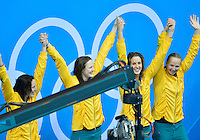 July 28, 2012: Australian 4x100m women's Freestyle Relay team wave at the fans during medal ceremony at the Aquatics Center on day one of 2012 Olympic Games in London, United Kingdom.