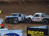 Mar. 20, 2011; Chandler, AZ, USA;  LOORRS pro two driver Robby Woods (99) gets spun by Carl Renezeder (17) during round two at Firebird International Raceway. Mandatory Credit: Mark J. Rebilas-