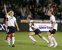Kristine Lilly after scoring from the penalty spot for the winning goal with NatashaKia and Abby Wambach. USA captured the 2006 Gold Cup at Home Depot stadium in Carson, California on November 26 2006 thanks to a penalty kick call by the referee with only seconds remaining in the last period of overtime. With the penalty kick score USA beat Canada 2-1.