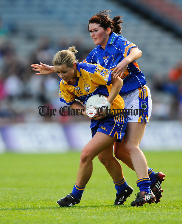 Clare's Una Downes is tackled by Tippearry's Mairead Morrissey during the Intermediate Ladies Football final at Croke Park. Photograph by John Kelly.