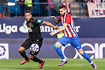 Yannick Ferreira Carrasco of Atletico de Madrid fights for the ball with Ruben Miguel Nunes Vezo of Granada CF during their La Liga match between Atletico de Madrid and Granada CF at the Vicente Calderon Stadium on 15 October 2016 in Madrid, Spain. Photo by Diego Gonzalez Souto / Power Sport Images