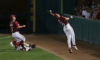Arkansas infielder Cullen Smith (14) catches, Saturday, June 5, 2021 during the third inning in the second game of the NCAA Fayetteville Regional at Baum-Walker Stadium in Fayetteville. Check out nwaonline.com/210606Daily/ for today's photo gallery. <br /> (NWA Democrat-Gazette/Charlie Kaijo)