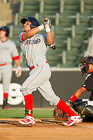 Sebastian Valle #9 of the Lakewood BlueClaws follows through on his swing against the Kannapolis Intimidators at Fieldcrest Cannon Stadium July 14, 2010, in Kannapolis, North Carolina.  Photo by Brian Westerholt / Four Seam Images