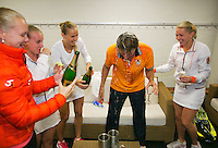 The Netherlands, Den Bosch, 20.04.2014. Fed Cup Netherlands-Japan, The Dutch team celebrates with champ[agne, l.t.r.: Kiki Bertens,Rachel Hogenkamp,Arantxa Rus, captain Paul Haarhuis and Michaella Krajicek<br /> Photo:Tennisimages/Henk Koster