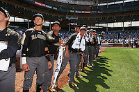 American team members including Carter Kieboom, Carter Aldrete, and Grae Kissinger watch from the warning track during the home run derby before the Under Armour All-American Game on August 15, 2015 at Wrigley Field in Chicago, Illinois. (Mike Janes/Four Seam Images)