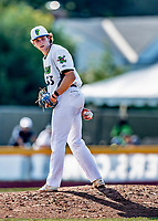 20 June 2021: Vermont Lake Monsters pitcher Patrick Harrington, from Bedford NH, glances to check the runner on first during a game against the Westfield Starfires at Centennial Field in Burlington, Vermont. The Lake Monsters fell to the Starfires 10-2 at Centennial Field, in Burlington, Vermont. Mandatory Credit: Ed Wolfstein Photo *** RAW (NEF) Image File Available ***