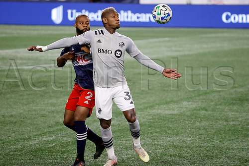 20th November 2020; Foxborough, MA, USA;  Montreal Impact forward Romell Quioto controls the ball in front of New England Revolution defender Andrew Farrell during the MLS Cup Play-In game between the New England Revolution and the Montreal Impact