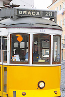 Old tram. Street view. Alfama district. Lisbon, Portugal
