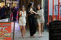 Pictured: Three women walk on Wind Street, Swansea, Wales, UK. Friday 20 December 2019<br /> Re: Black Eye Friday (also known as Black Friday, Mad Friday, Frantic Friday) the last Friday before Christmas, in Swansea, Wales, UK.