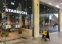 Starbucks remains open for customer to buy coffee but shuts the option to sit in store in the town centre on March 19, 2020 in High Wycombe, United Kingdom during the COVID-19 pandemic causing people to panic buy items. Photo by Andy Rowland.