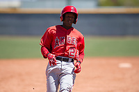 Los Angeles Angels shortstop Daniel Ozoria (23) hustles to third base during an Extended Spring Training game against the Chicago Cubs at Sloan Park on April 14, 2018 in Mesa, Arizona. (Zachary Lucy/Four Seam Images)
