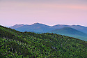 A mid summer sunrise unfolds over the Moat Mountain Range in New Hampshire's White Mountains.