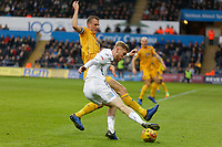Oli McBurnie of Swansea City (R) challenged by Dan Burn of Wigan Athletic during the Sky Bet Championship match between Swansea City and Wigan Athletic at the Liberty Stadium, Swansea, Wales, UK. Saturday 29 December 2018