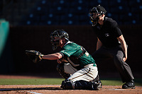 Greensboro Grasshoppers catcher Eli Wilson (29) sets a target as home plate umpire Tyler Witte looks on during the game against the Hudson Valley Renegades at First National Bank Field on September 2, 2021 in Greensboro, North Carolina. (Brian Westerholt/Four Seam Images)