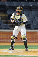 Wake Forest Demon Deacons catcher Garrett Kelly (28) checks the runner at first base during the game against the Marshall Thundering Herd at Wake Forest Baseball Park on February 17, 2014 in Winston-Salem, North Carolina.  The Demon Deacons defeated the Thundering Herd 4-3.  (Brian Westerholt/Four Seam Images)