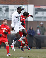 University of Connecticut forward Stephane Diop (5) and University of New Mexico defender Adrian Mora Delgado (2) battle for head ball. .NCAA Tournament. With a goal in the second overtime, University of Connecticut (white) defeated University of New Mexico (red), 2-1, at Morrone Stadium at University of Connecticut on November 25, 2012.