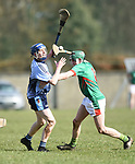 Martin Walsh of Scariff Community College in action against Diarmuid Conway of St Fergal's College during their All-Ireland Colleges final at Toomevara. Photograph by John Kelly.