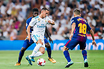 Lucas Vazquez (c) of Real Madrid competes for the ball with Samuel Umtiti (l) and Jordi Alba Ramos of FC Barcelona during their Supercopa de Espana Final 2nd Leg match between Real Madrid and FC Barcelona at the Estadio Santiago Bernabeu on 16 August 2017 in Madrid, Spain. Photo by Diego Gonzalez Souto / Power Sport Images