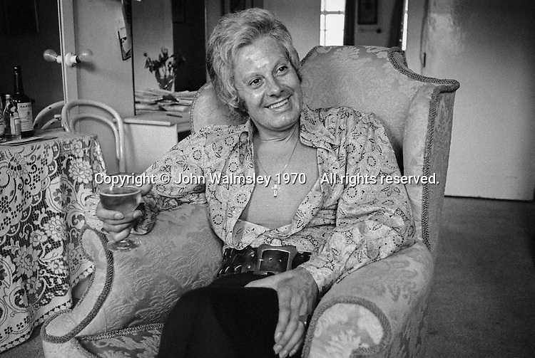 """Danny La Rue, performer, female impersonator, drag queen (but he preferred to be known as a """"Comic in a frock""""), in his dressing room at the Palace theatre, London, 1970.  He was born Daniel Patrick Carroll in 1927 in Cork, Ireland."""