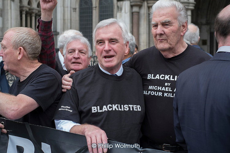 John McDonnell MP & Blacklist Support Group celebrate outside the Royal Courts of Justice after victory in their campaign for compensation for  illegal blacklisting of construction workers.