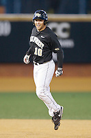Nate Mondou (10) of the Wake Forest Demon Deacons jumps in the air after hitting a walk-off single in the bottom of the 9th inning against the Missouri Tigers at Wake Forest Baseball Park on February 22, 2014 in Winston-Salem, North Carolina.  The Demon Deacons defeated the Tigers 1-0.  (Brian Westerholt/Four Seam Images)