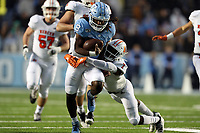 CHAPEL HILL, NC - NOVEMBER 23: Michael Carter #8 of the University of North Carolina is tackled by Eric Jackson #7 of Mercer University during a game between Mercer University and University of North Carolina at Kenan Memorial Stadium on November 23, 2019 in Chapel Hill, North Carolina.